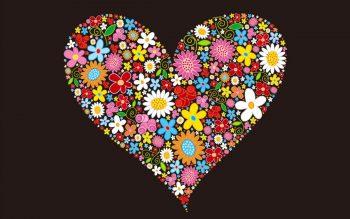 Черный фон с сердцем из цветов